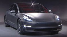 Tesla unveils its much-anticipated Model 3 electric car saying it will cost $35,000 and have a range of at least 215 miles (346km) per charge.