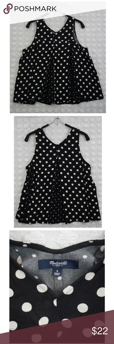 """Women's Madewell Black White Polka Dot Blouse SZ 4 BRAND Madewell  STYLE Sleeveless Blouse - RN77388  SIZE 4  COLOR Black White polka dot larger scale pattern, dots about 1/2"""" in Diameter  MATERIAL 100% Viscose   MEASUREMENTS Pit to Pit and doubled: 34"""" Length (measured from front of V at neck (front) to bottom of garment): 18""""   NOTES Great Used Condition No odor or smells No Rips or Tears Found  ALL PHOTOS TAKEN WITH GARMENT LAYING FLAT. Madewell Tops Tank Tops"""