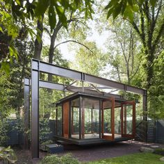 hanging tea house by architect David Jameson, inspired by a lantern hanging in the garden
