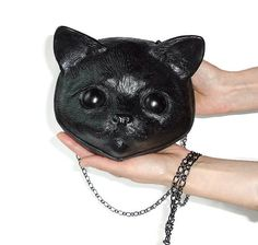 Cat bag. For people liking the unusual and exclusive things. A roomy bag.  Genuine leather and rubber. The Bag is sewn on the lining. Bag