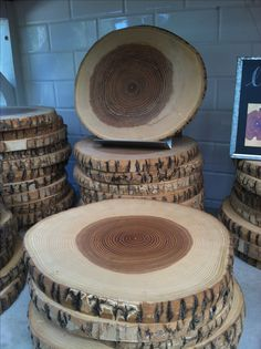 Wood slices!! These would make great trivets or could be used for a setting for centerpieces at weddings! Think I will find me a log!