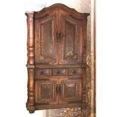 Awesome Armoire With Hand-Hammered Copper Panels. h1Awesome Armoire With Hand-Hammered Copper Panels_h1This tremendous armoire features a rust-colored finish, with large double doors above, smaller double doors below, and 3 drawers, each with hand-hammered copper panels .. . See More Armoires at http://www.ourgreatshop.com/Armoires-C1067.aspx
