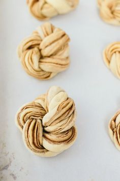 These Pumpkin Spiced Braided Brioche Knots are scrumptious, and taste like cinnamon rolls! They're the perfect recipe for any fall occasion, especially Thanksgiving!