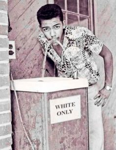 "Photographer Cecil Williams drinking at white only fountain (1964). He had a ""SENSE OF HUMOR .......Or a DEATH WISH!! #CivilRights #NoColorLines"