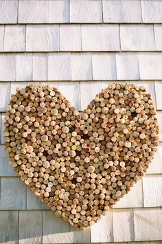 DIY cork heart: http://www.stylemepretty.com/2015/01/15/new-england-barn-wedding-with-touch-of-glam/ | Photography: Ruth Eileen - http://rutheileenphotography.com/
