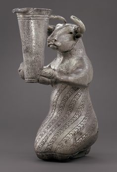 Kneeling bull holding a spouted vessel, 3100–2900 b.c.; Proto-Elamite period  Southwestern Iran  Silver
