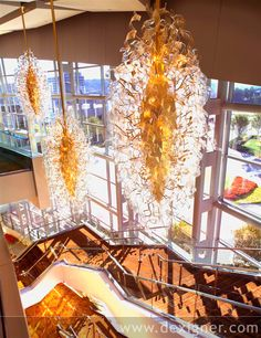 Murano glass ribbons attached to gilded metal light up the staircase in the Cobb Energy Performing Arts Centre in Atlanta