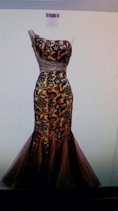 Bellísimo vestido de encaje negro y fondo color champange
