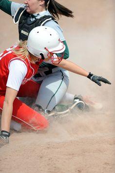Cardinal softball player slides into base. SVSU vs. Tiffen