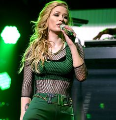 Iggy Azalea performs onstage during Y100's Jingle Ball 2014 at BB&T Center on December 21, 2014 in Miami, FL