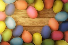 colorful easter eggs on wooden floor