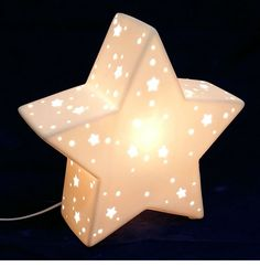 Ceramic night light with pin holes and star shapes, cool to the touch and gives off a soft soothing glow for that perfect night light Star Night Light, Stars At Night, Night Lights, Star Lamp, Ceiling Shades, Incandescent Bulbs, Star Shape, White Porcelain, Little Ones