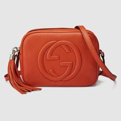 "Gucci NWT Soho Leather Disco Bag Sun Orange New with Tags and Box Sun Orange leather a/ tassel. Embossed interlocking G Interior phone and open pockets/Adjustable leather strap with 21.6"" drop/Top zip closure/Small/8""W x 6""H x 2.7""D/Cotton linen lining/Made in Italy Authentic. Gucci Bags Crossbody Bags"