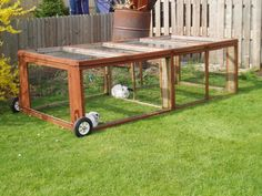 Outdoor rabbit hutch with wheels. Allows they to roam and snack while being protected.  needs watering jug.
