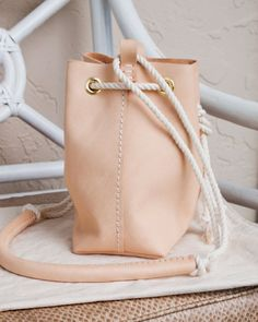 Mini bucket bag made of creamy milled vegetable tanned leather. This lovely little bucket bag is a beautiful light nude leather right now, and
