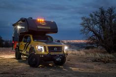SEMA vehicle Nissan Titan and Lance camper