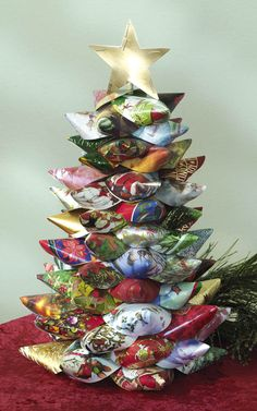 Don't throw out your Christmas cards after the holiday season! Use them to make this beautiful Christmas tree.