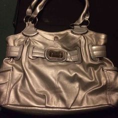 Silver Rosetti purse Big silver purse. Plenty of inside pockets. Got as a gift and never used it. Rosetti Bags Shoulder Bags