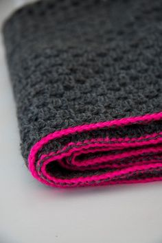 Charcoal grey granny square blanket with pink trim, granny chic