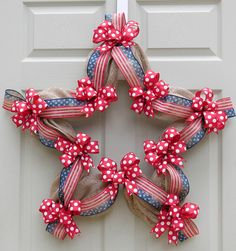 A star-shaped wreath with simple accents of poly burlap, stars and stripes vintage ribbon, and red/white dotted bows. This is perfect for the of July or to show your patriotism any time of the yea Patriotic Wreath, Patriotic Crafts, July Crafts, 4th Of July Wreath, Wreath Crafts, Diy Wreath, Ornament Wreath, Wreath Ideas, Holiday Wreaths