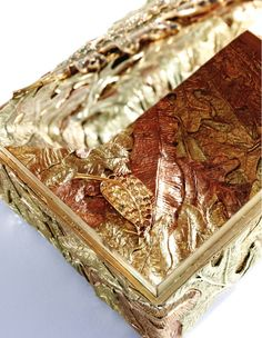 Oak Leaf Box Open. From the estate of Bunny Mellon.  Overlapping layers of hand-carved gold oak leaves. Lot Sold: $125,000.00