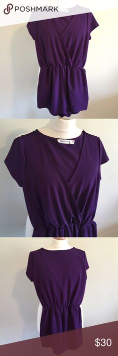 Buddy Love Purple Romper!!! Super cute romper!! Great for gameday or girls night out!!  Your tailgate outfit has never looked so good! The Tiana Romper is perfect for any game day! Throw on a pair of boots and wear your team color in style! Size Small is equivalent to a 2/4.   Product Details: Elastic waist Crosses and drapes in the front Hand wash cold or dry clean Made in the U.S.A. Buddy Love Other