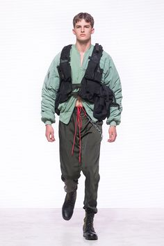 """Heliot Emil Spring/Summer 2018 collection is titled """"P .T .C .S."""" short for post traumatic combat stress. The collection follows the aesthetic of an individual dealing with a postwar existential crisis, resulting in experimentation with a combination... »"""