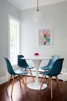 """Jennifer loves the new kitchen and especially the breakfast nook with teal chairs, Saarinen-esque tulip table, and <a href=""""http://www.westelm.com/products/globe-pendant-milk-finish-w1047/?pkey=cpendants%7C%7C"""" target=""""_blank"""">West Elm globe light</a>."""