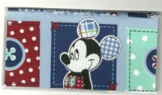 "Disney Mickey Mouse Denim Patch Squares Checkbook Cover by Tickled Pink Boutique. $5.99. The sturdy clear VINYL COVER encases a fabric bonded design. Measuring 6 1/4"" x 3 1/4"",  the cover fits all standard bank checkbooks.  All checkbook covers come with a register flap and a duplicate check flap  just like the bank, only flashier."