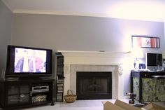 and we are loving how it looks. the long term plan is to create some built-in shelves on either side of the fireplace. my desk is o. Diy Tv Wall Mount, Best Tv Wall Mount, Wall Mounted Tv, Built In Shelves, Built Ins, Hide Tv Wires, Tv Cords, Hide Cables, Tv Over Fireplace