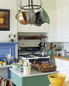 Teal with copper pots would be nice. But what color Le Creuset? Oh the agony of choice.