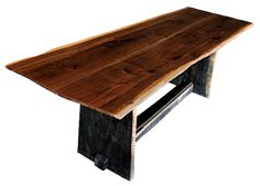 http://www.60nobscot.com/images/furniture/Walnut%20Dining%20Table.jpg