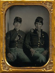 A super sharp looking quarter plate ambrotype of a pair of New York infantrymen. Both are dressed in New York jackets. The fellow to the left is wears a pair of corporal's chevrons. There is brass on top of the cap, but it can't be made out. Image is in a full leatherette case with a separated spine.