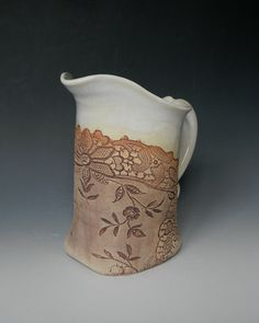 This is soooooo pretty.  Pottery made with an impression of antique lace.