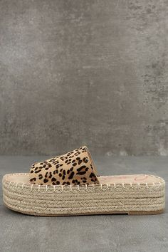 You'll be the cutest girl on the pier in the Coolway Bora Leopard Pony Fur Flatform Espadrille Slides! A wide leopard print toe strap, made from genuine pony fur, dresses up these sun-ready espadrille flatforms! Available in Euro sizes 37-41.