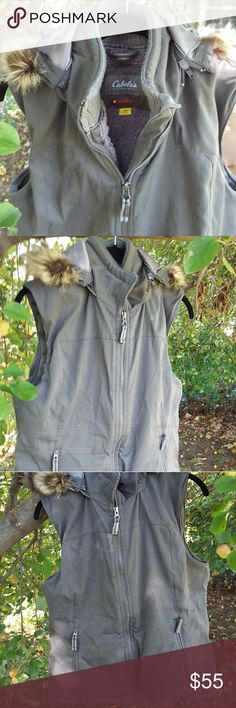Cabela's Primaloft women's vest in smoke grey NWOT Cabela's vest with removeable hood with fur trim. Features durable water repellent shell, and 140 gram primaloft insulation for warmth. Zippered hand warming pockets. Looks very warm & cozy. Cabela's Jackets & Coats Vests