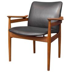 Finn Juhl Armchair Model 192 | From a unique collection of antique and modern armchairs at https://www.1stdibs.com/furniture/seating/armchairs/