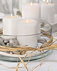 HAVING THIS (with a purple flower placed within pebbles) AS TABLE DECORATIONS! - citronella candles to keep unwanted bugs away!