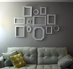 I love empty white frames on a grey or white wall. I wish we had the space for this.