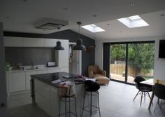 We supplied and installed the dark grey aluminium windows as well as the sliding doors and timber front door into this renovation project in Bearsted, Kent.