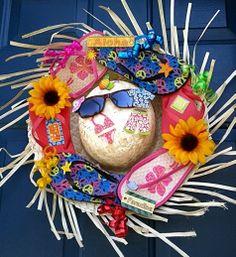 Straw hat wreath with flip flops. http://www.completely-coastal.com/2014/06/straw-hat-wreaths.html