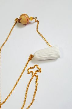 Unique Long Chain Necklace, Golden Plated Chain Pendant Necklace, One of a Kind White Clay Pendant Necklace, White and Gold Chain Necklace Long Chain Necklace, Necklace Lengths, Tassel Necklace, Pendant Necklace, White Clay, Unique Necklaces, Chain Pendants, Wooden Beads, Statement Jewelry