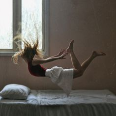 falling on bed.  Someone needs to do a Fail of this photo