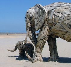 by Andries Botha (South African Artist) and his team.  Recyled Wood |  http://andriesbotha.net/