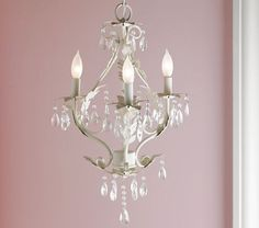 I love a chandelier in a nursery. This one is simple, clean, and adds a little shabby chic glam to a room.