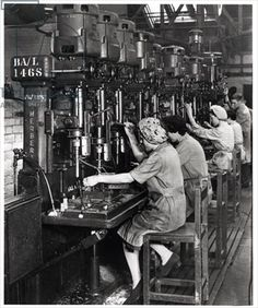 1939-1945 Women at work, drilling and reaming aircraft wing spar fittings for Blackburn Aircraft, Olympia Works, Leeds.