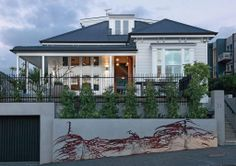 Philippe designed the garage door to complement the property's fencing.