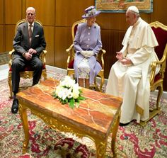 Pope Francis, the Queen and Prince Philip talk at the Vatican while seated on elegant red chairs, 03.04.14