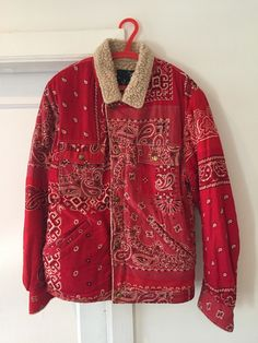 For sale is an Visvim-Indigo Camping Trailer Kerchief 'Bandana' trucker jacket in Red.  It is a size 52.   The coat is in perfect condition and has been worn once. I'm a 50, but it fits fine, enough room for a hoodie. This jacket was bought at ICT in Tokyo. It was the last one in Japan.  Not in a hurry to sell, but open to offers.  Do not hesitate to ask any questions!