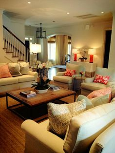 Like the coral color pillows for accent.